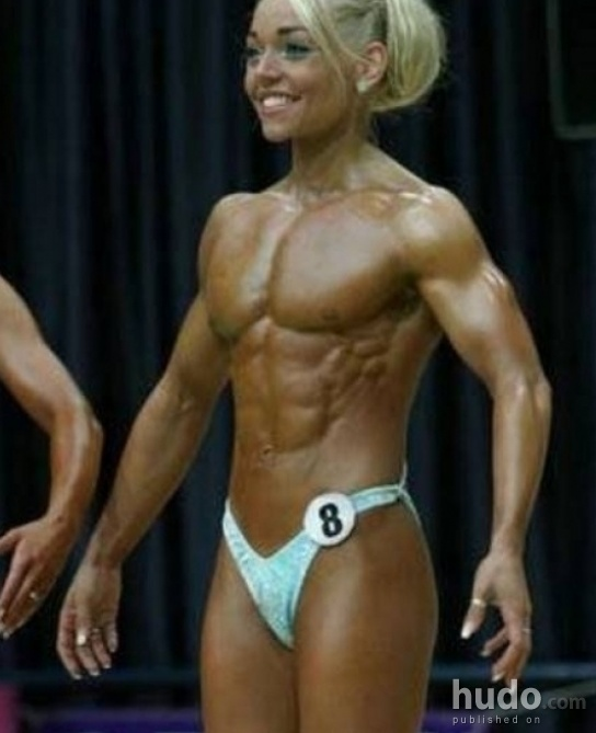 Ripped female bodybuilder ironfire works out and poses 7